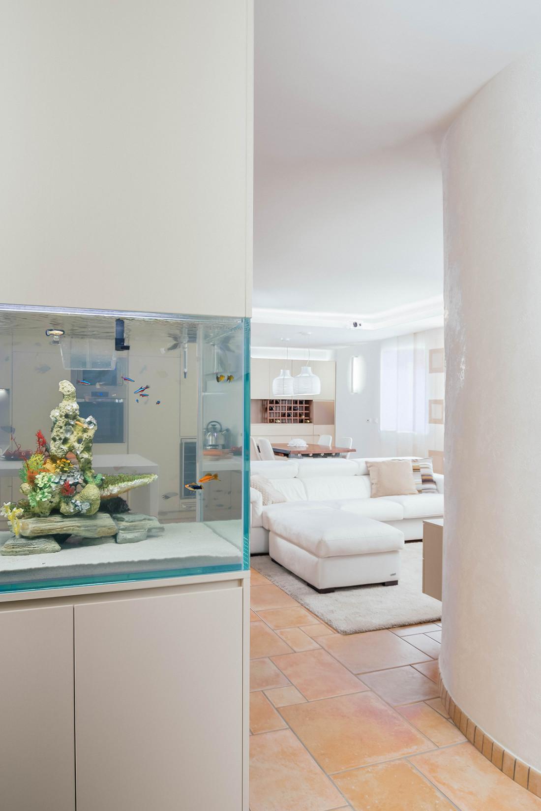 Casa_A+M. Ingresso acquario. Living. Sala da pranzo